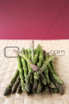 Asparagus stalks on a woven mat