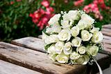 close up of wedding bouquet on wooden bench