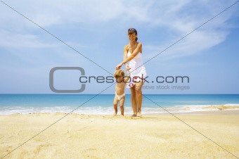 with  baby on beach
