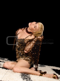 Beauty woman sits on carpet in incline.