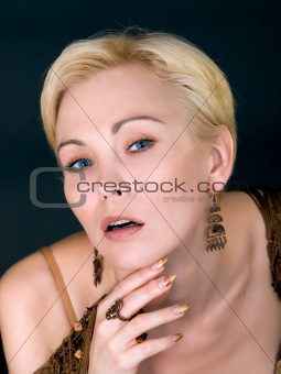 Beauty blonde woman with blue eyes.
