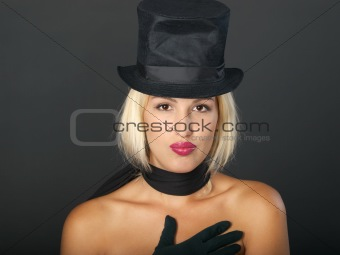 Blonde woman in black hat and scarf.