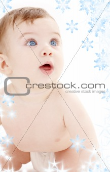 portrait of crawling baby boy looking up