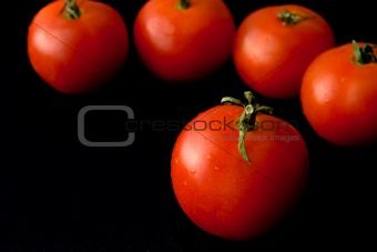 Tomatoes on a black background