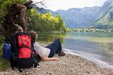 Female hiker resting at a mountain lake