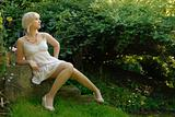 attractive blond girl in garden