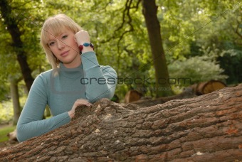 attractive blond girl in woods
