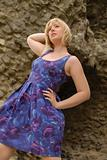 stylish blond girl in purple dress