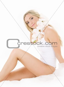 blonde in cotton underwear with orchid