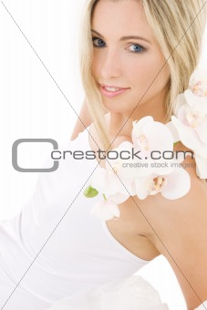 blonde in cotton underwear with orchid