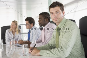 Four businesspeople in a boardroom