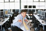 Businessman standing in karate stance in computer room