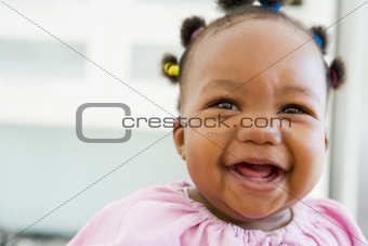 Baby indoors laughing