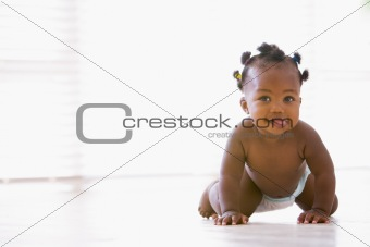 Baby crawling indoors