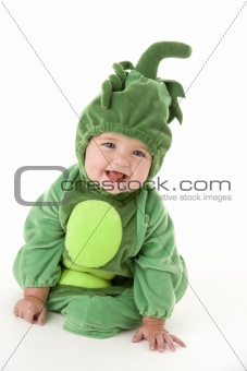 Baby in peas in pod costume smiling