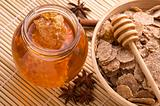 fresh honey with honeycomb, spices and breakfast flakes