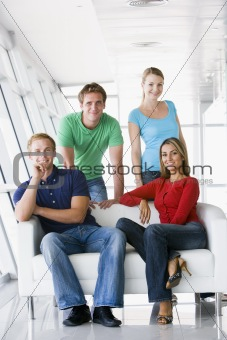 Four people in lobby smiling