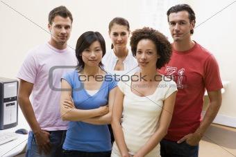 Five people standing in computer room