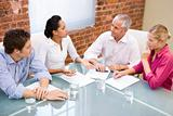Four businesspeople in boardroom meeting