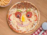 Smiley Faced Pizza with a Portion of Chips