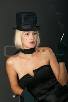 Blonde variety show woman with cigarette.
