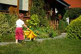 little girl having fun in garden