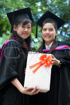 Beautiful Asian university graduate celebrating her success.