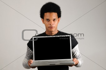 African man holding laptop computer