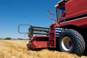 combine harvester on field
