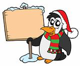 Christmas penguin with sign