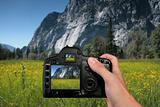 Tourist Taking a Landscape Photograph