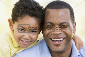 Man and young boy outdoors smiling