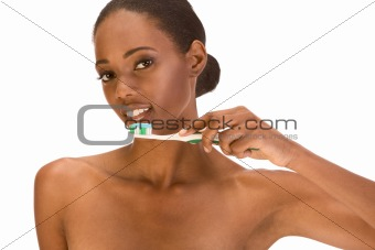Young Afro American girl brushing her teeth