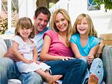 Family sitting on patio smiling