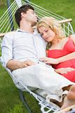 Couple sleeping in hammock