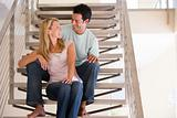 Couple sitting on staircase smiling