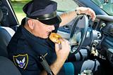 Police Officer Eating Donut