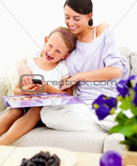 Smiling mother and daughter sitting together