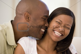 Couple in living room smiling