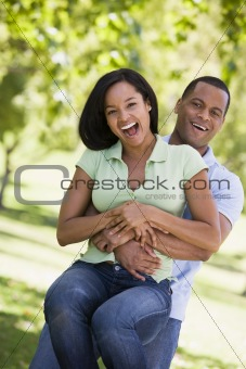 Couple being playful outdoors smiling