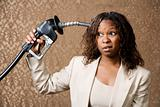 Woman Holding Gas Nozzle to her Head