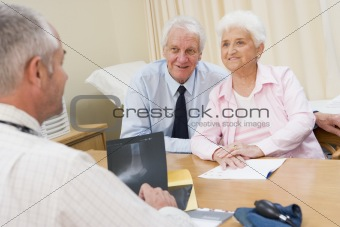 Couple in doctor's office smiling