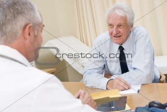 Man in doctor's office smiling