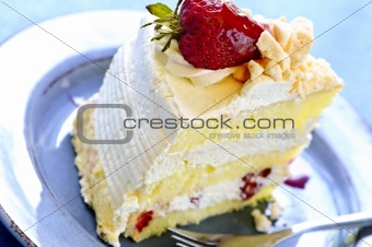 Slice of strawberry meringue cake