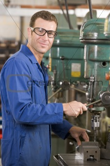 Machinist working on machine