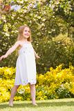 Young girl standing outdoors smiling