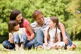 Family outdoors smiling
