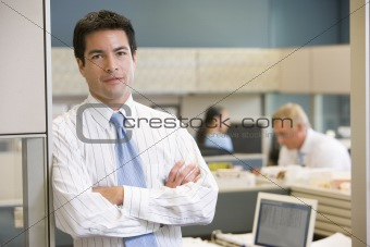 Businessman standing in cubicle