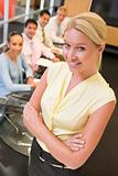 Businesswoman with four businesspeople at boardroom table in bac