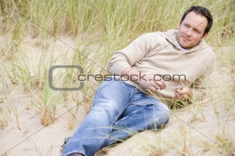 Man sitting back on beach